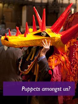 Man wearing dragon puppet